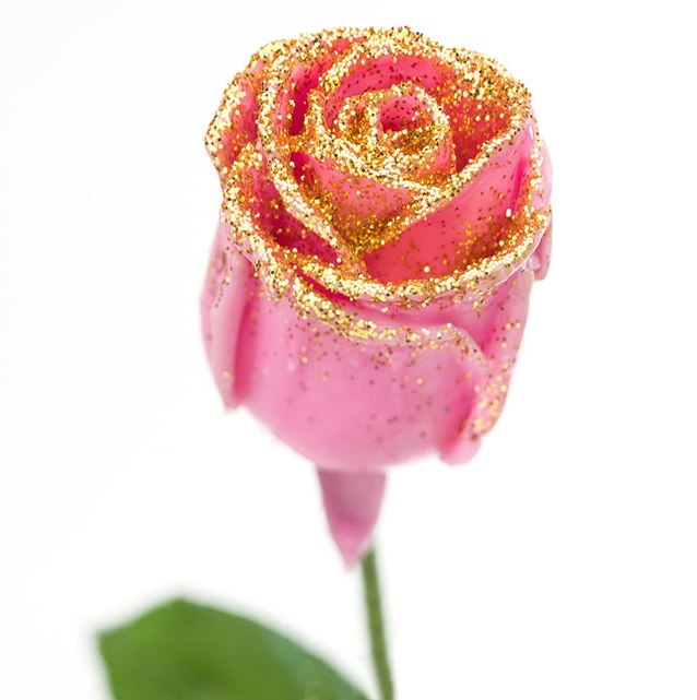 Bouquet of pink waxed Roses big flowers and gold sparkles